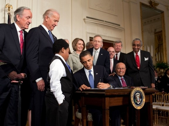 Barack Obama signing the Patient Protection and Affordable Care Act at the White House, March 23, 2010