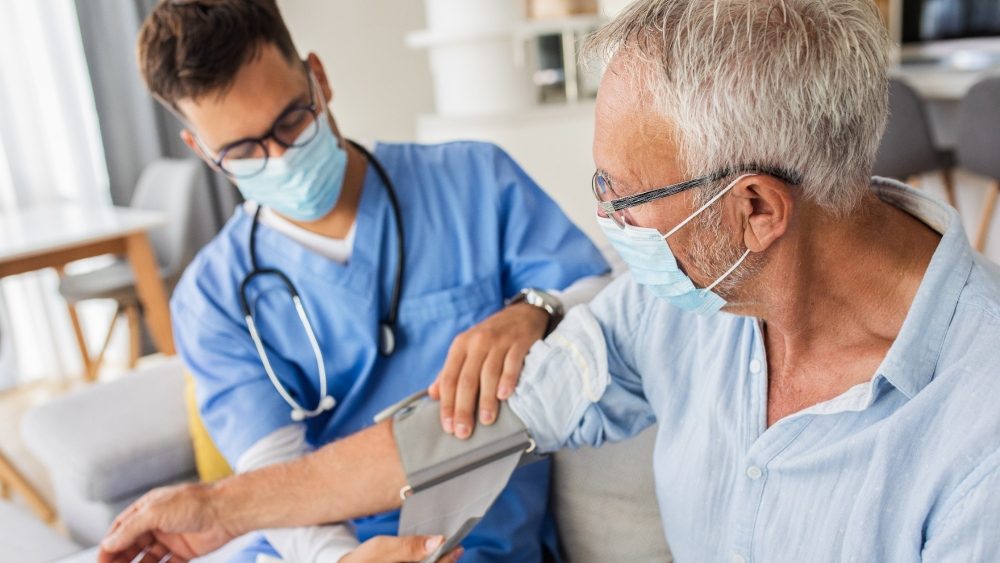 Health Care Reform written on white background surrounded by pills, syringes, top of stethoscope, and prescription pad