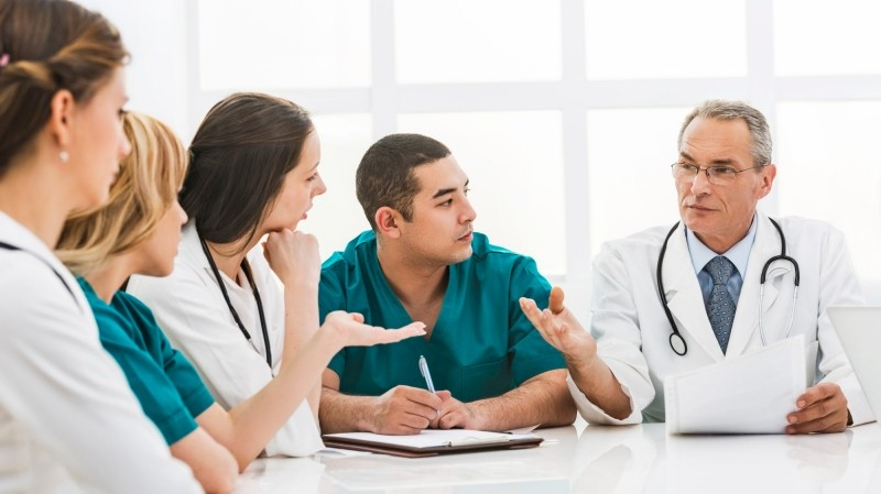 Group of doctors and nurses having a meeting