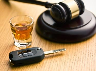 Gavel, alcoholic drink, and car keys