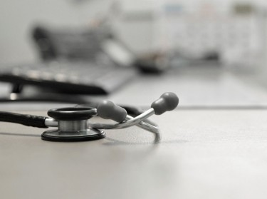 Stethoscope on doctor's desk