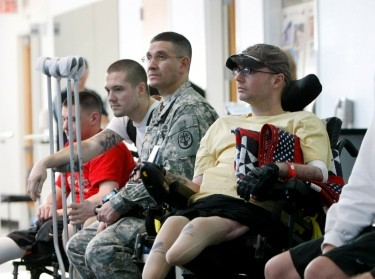 Service members involved in physical therapy at Brooke Army Medical Center in San Antonio wait for President Bush to visit