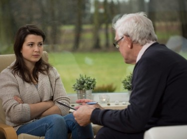 A young woman talks with a psychiatrist