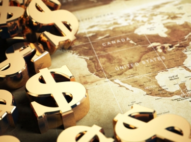Gold dollar signs surrounding a map of the United States