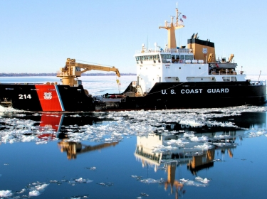 The crew of the Coast Guard Guard Cutter Hollyhock, homeported in Port Huron, Mich., transits Lake St. Clair en route to the western basin of Lake Erie for ice-breaking operations, Jan. 13, 2015. U.S. and Canadian Coast Guard ice breakers, as part of Operations Coal Shovel and Taconite, have been working tirelessly to keep vessel traffic and important economic supplies moving throughout the Great Lakes.