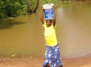 Kenyan woman carrying water