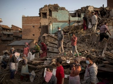 Residents clear debris as they look for their belongings from collapsed houses following Saturday's earthquake in Bhaktapur, Nepal, May 1, 2015
