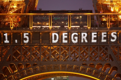 """The slogan """"1.5 Degrees"""" is projected on the Eiffel Tower as part of the World Climate Change Conference 2015 (COP21) in Paris, France, December 11, 2015"""