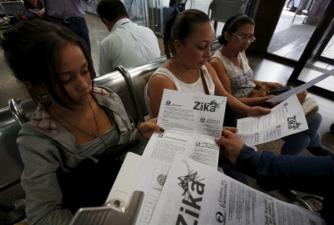 Colombian women listen as a health worker distributes information how to prevent the spread of the Zika virus in Bogota, Colombia January 31, 2016