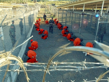 U.S. military police guard detaintees in Guantanamo Bay