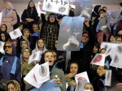 Iranian women holding electoral leaflets attend a reformist campaign for upcoming parliamentary election, in Tehran February 18, 2016