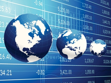 Composite image of globes in front of currency exchange board