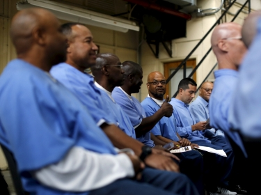 Prisoners after a graduation ceremony from a computer coding program at San Quentin State Prison in San Quentin, California, April 20, 2015