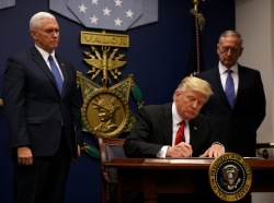 U.S. President Donald Trump signs an executive order intended to impose tighter vetting to prevent foreign terrorists from entering the United States, January 27, 2017