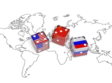 Dice representing flags of United States, China, and Russia on a world map