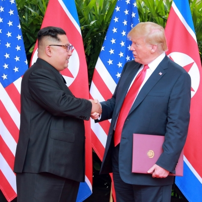 North Korean leader Kim Jong Un shakes hands with U.S. President Donald Trump at the Capella Hotel on Sentosa island in Singapore, June 12, 2018