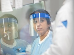 A lab technician begins semi-automated testing for COVID-19 at Northwell Health Labs on March 11, 2020 in Lake Success, New York.