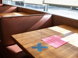 Tables are marked off at J. Christopher's restaurant that now offers dine-in service on April 27, 2020 in Decatur, Georgia.