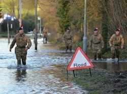 Soldiers from the Royal Regiment of Fusiliers in flooded Staines-Upon-Thames, photo by Cpl Richard Cave LBPPA/Crown Copyright CC BY-NC 2.0