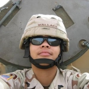 Antoinette Wallace standing inside a U.S. tank turret while on active National Guard duty in Iraq in 2005