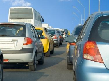 cars in a traffic jam under blue sky