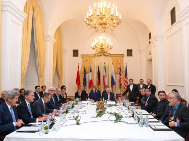Delegations of U.S. Secretary of State John Kerry, Britain's Foreign Secretary Philip Hammond, Russian Foreign Minister Sergei Lavrov, Iranian Foreign Minister Javad Zarif, German Foreign Minister Frank-Walter Steinmeier, French Foreign Minister Laurent Fabius, EU High Representative Catherine Ashton, Chinese Foreign Minister Wang Yi sit around the negotiations table during their meeting in Vienna November 24, 2014