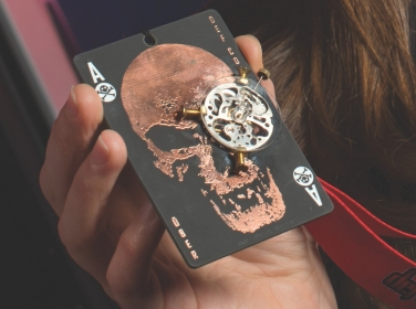 Close up of Lily Ablon holding DEFCON 21 challenge medal