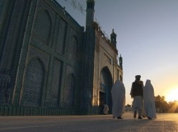 Muslim morning prayer. Blue Mosque in Afghanistan.