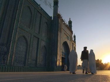 Muslim morning prayer. Blue Mosque in Afghanistan.