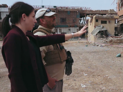 Shelly Culbertson and a United Nations Mine Action Service Implementation Partner survey the grounds of the Al-Shifa Hospital complex in Mosul, Iraq.