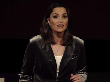 RAND's Kathryn Bouskill speaks at a TEDxManhattanBeach event.