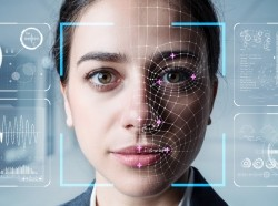 A woman getting authenticated by facial recognition technology, photo by metamorworks/Getty Images