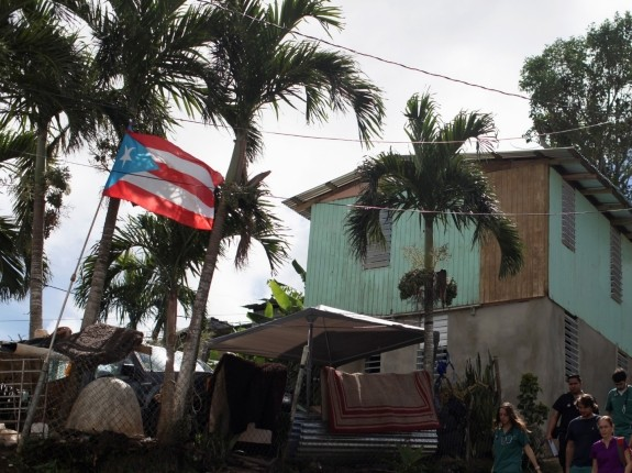 Doctor Maria Alonso (R, purple shirt) and medical students from the University of Puerto Rico visit patients in a neighbourhood affected by Hurricane Maria in September, in Corozal, Puerto Rico January 20, 2018, photo by Alvin Baez/Fotostation