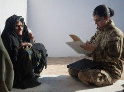 A U.S. Army sergeant, part of a Female Engagement Team in Afghanistan, gathering information from women so that blankets and winter clothing can be distributed to the women and their families, photo by Spc. Kristina Truluck/U.S. Army