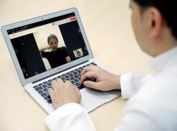 Medical doctor Makoto Kitada demonstrates a telemedicine application service, photo by Issei Kato/Reuters