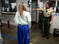 Sheriff's deputies register new arrivals at the Los Angeles County Women's jail in Lynwood
