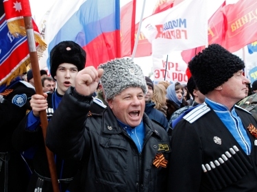 Cossacks attend a rally to support the annexation of Ukraine's Crimea to Russia in the Russian southern city of Stavropol, March 18, 2014
