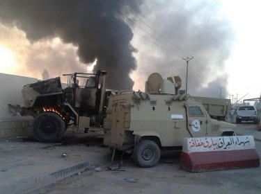 Iraqi military vehicles damaged during an attempt to repel rebel forces invading Mosul