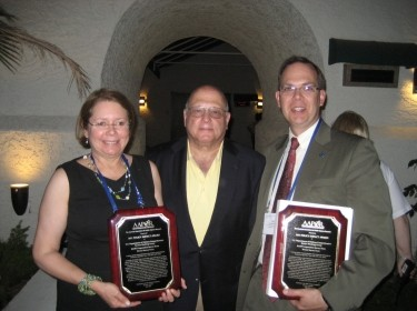Sandy Berry (RAND), Bernie Rostker (RAND), and Jay Goodwin (DoD) accepting 2011 Policy Impact Award from American Association for Public Opinion Research