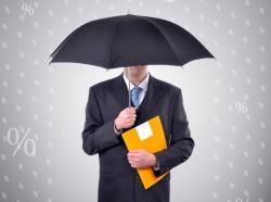 A man under an umbrella while it's raining percentage symbols