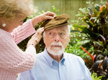 an elderly couple, man possibly with dementia