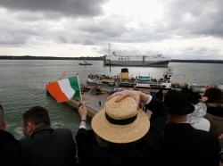 Woman waves an Irish flag in Southampton, England