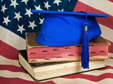 American flag, books, and graduation cap