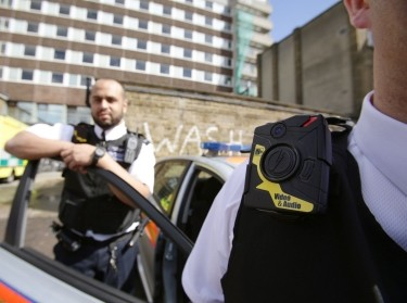 Police constables wearing body-worn video (BWV) cameras, before a trial by the Metropolitan police, at Kentish Town in London, May 6, 2014