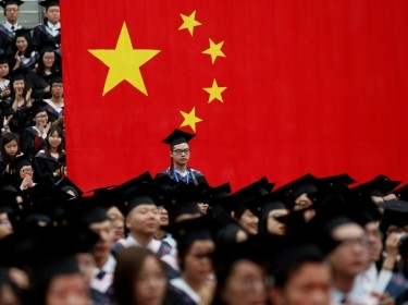 Students attend a graduation ceremony at Fudan University in Shanghai, China, June 23, 2017