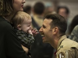 An Airman assigned to the 480th Expeditionary Fighter Squadron reunites with his family during the squadron's return to Spangdahlem Air Base, Germany, Oct. 12, 2016