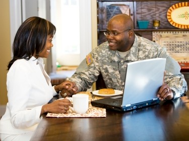 A U.S. soldier and his wife talking over breakfast
