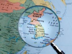 Close up of Korea map thru a magnifying glass