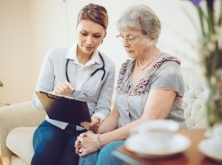 Doctor speaking with an elderly patient