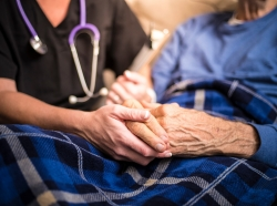 A hospice nurse visiting an elderly patient